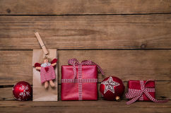 Christmas presents on wooden background with angel and red white Royalty Free Stock Image