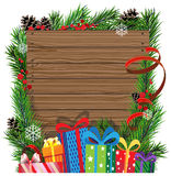 Christmas presents on wooden board Stock Photography