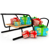 Christmas presents on a wooden sledge over white Royalty Free Stock Images