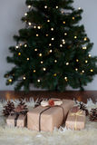 Christmas presents wrapped in front of the tree royalty free stock photography