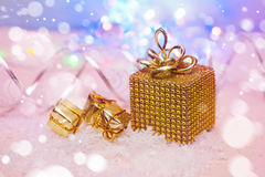 Christmas presents wrapped in gold Royalty Free Stock Images