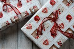 Christmas presents wrapped in green, red and white paper, decorated with ribbons royalty free stock image
