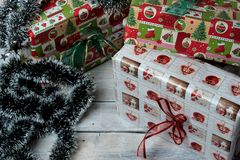 Christmas presents wrapped in green, red and white paper, decorated with ribbons stock photography