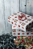 Christmas presents wrapped in green, red and white paper, decorated with ribbons stock images