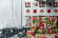 Christmas presents wrapped in green, red and white paper, decorated with ribbons stock photos