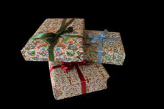 Christmas presents wrapped in paper with bows Stock Images