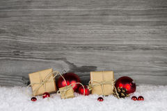 Christmas presents wrapped in paper decorated with red balls on Royalty Free Stock Photography