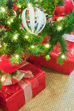 Christmas presents wrapped in red under a decorated christmas tr Stock Photo