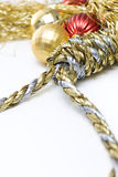Christmas Pressures. Noose made out of christmas rope, with baubles in the background, isolated on white Royalty Free Stock Photography