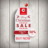 Christmas Price Sticker Wood Pin. Price sticker with emblem for the christmas sale on the wooden background Stock Photo