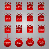 Christmas pricing tags - red gift and bauble shapes Stock Photos