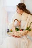 Christmas princess in a fur coat Stock Image