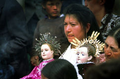 Christmas procession Ecuador. Woman with two child christ dolls walking in christmas procession, Cuenca, Peru Stock Image
