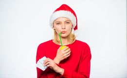 Christmas profit concept. Lemon money concept. Symbol of wealth and richness. Rich girl with lemon and money. Girl santa. Hat drink juice lemon while hold pile royalty free stock images