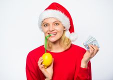 Christmas profit concept. Symbol of wealth and richness. Rich girl with lemon and money. Lemon money concept. Girl santa. Hat drink juice lemon while hold pile stock image