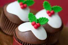 Christmas pudding cupcakes Stock Photos