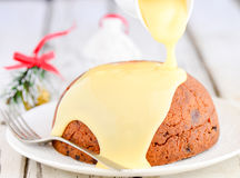 Christmas pudding with custard Royalty Free Stock Photo