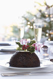 Christmas Pudding On Dining Table Stock Images