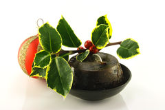 Christmas Pudding with Holly and Bauble Royalty Free Stock Image