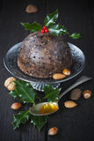 Christmas pudding with holly twig Stock Photo