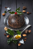 Christmas pudding with holly twig Royalty Free Stock Photos