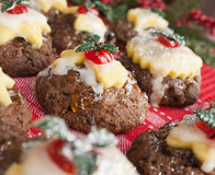 Christmas pudding, icing, marzipan, holly. Mini Christmas pudding covered with icing, marzipan, red cherries, sticky orange marmalade and with mini holy stock photography