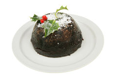 Christmas pudding on a plate Stock Photos