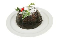 Christmas pudding on a plate Stock Photos