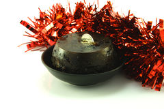 Christmas Pudding with Sixpence and Tinsel Stock Photos
