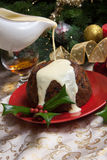 Christmas Pudding With White Sauce Royalty Free Stock Photo