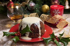 Christmas Pudding With White Sauce Stock Image