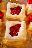 Christmas puff pastry cookies with cranberry Stock Photos