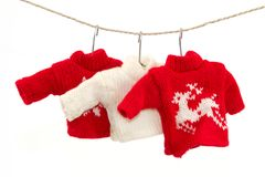 Christmas pullover 1. Three pullovers and a clothesline with a white background Stock Photography