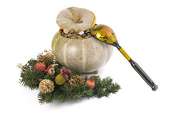 Christmas pumpkin. The pumpkin filled with metal coins with a wooden spoon and New Year's ornaments stock image