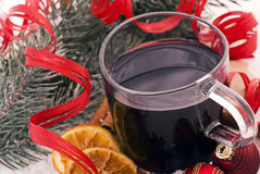 Christmas Punch. Hot wine punch with Christmas decoration as closeup in snow Royalty Free Stock Photos
