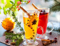 Christmas punch. Orange and cranberry punch with orange slices and spices.Hot drinks for winter and Christmas royalty free stock photography