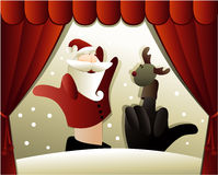 Christmas puppet show with Santa Claus Royalty Free Stock Image