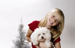 Christmas Puppy!. Happy Tween celebrating Christmas with her new Best Friend Royalty Free Stock Photography