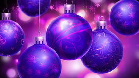 Christmas purple abstract background with big decorated blue/purple balls at the foreground Stock Photos