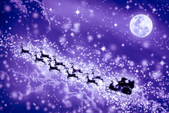 Christmas purple background. Silhouette of Santa Claus flying on Stock Photo