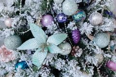 Christmas purple and silver decorations on the Christmas tree, snowflakes balls garlands, closeup texture background.  royalty free stock photography