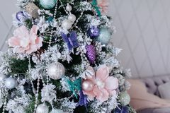 Christmas purple and silver decorations on the Christmas tree, snowflakes balls garlands, closeup texture background royalty free stock photography