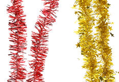 Christmas purple tinsel with stars. Royalty Free Stock Photo