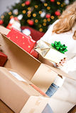 Christmas: Putting Wrapped Gifts In Box Stock Photo