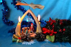 Christmas pyramid with candles, a wreath of fir branches and flo stock images