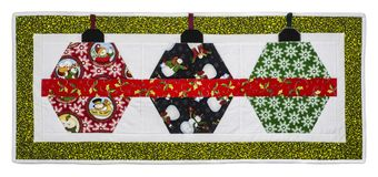 Christmas Quilt. With green and white border, colors fabrics  on a white background with path icluded Royalty Free Stock Photo