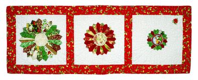 Christmas Quilt. With red border and colors fabrics isolated on a white background with path icluded Stock Photos