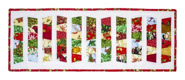 Christmas Quilt. With red border and colors fabrics isolated on a white background with path icluded Royalty Free Stock Photo