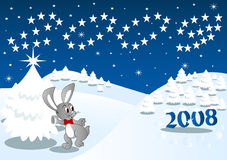 Christmas rabbit. A rabbit is sending off the old year Royalty Free Stock Photo