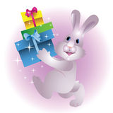 Christmas rabbit with gifts Royalty Free Stock Photo